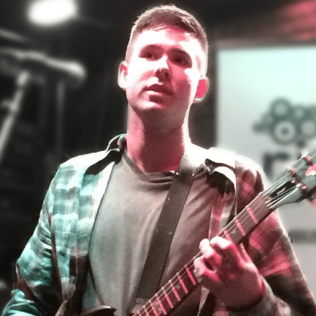 Justin Smith (Vocals and Guitar)